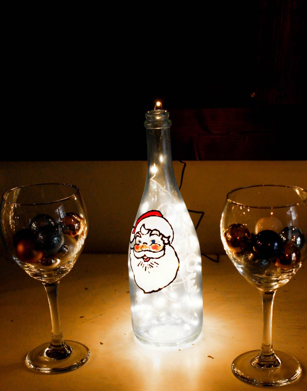 Santa Wine Painted Glass Bottle - Christmas Painted Wine Bottles by Atlanta style blogger Happily Hughes