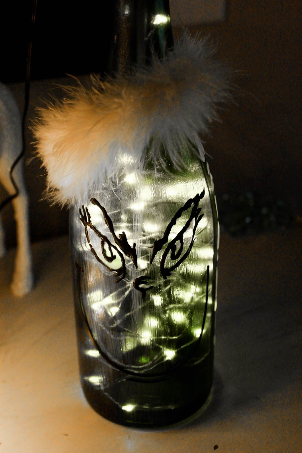 Grinch Wine Painted Bottle - Christmas Painted Wine Bottles by Atlanta style blogger Happily Hughes