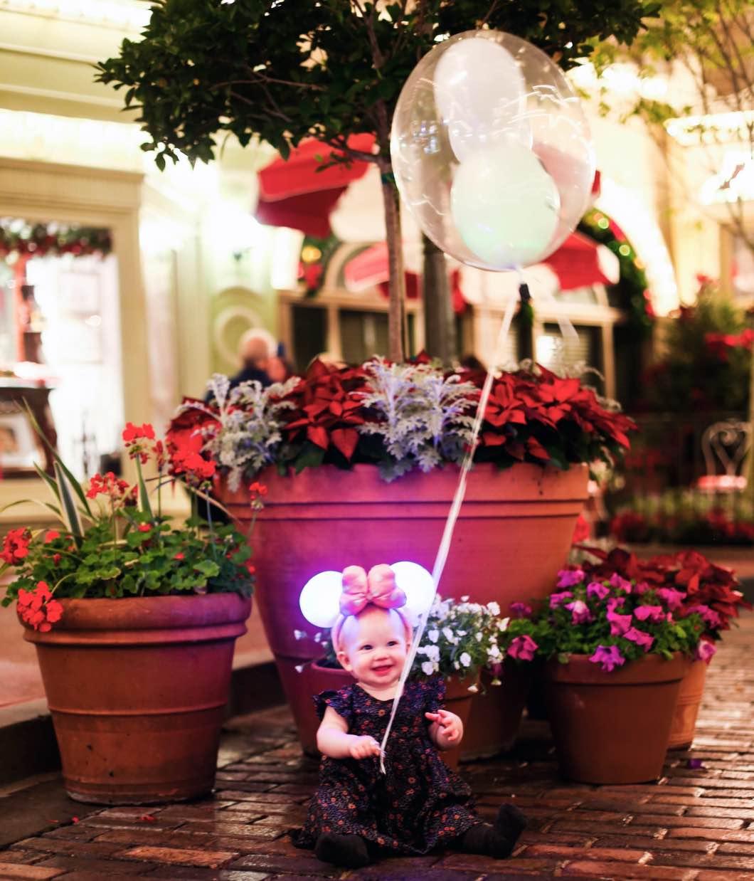 Mickeys Very Merry Christmas Main Street baby - Holiday Attractions in Orlando by Atlanta travel blogger Happily Hughes
