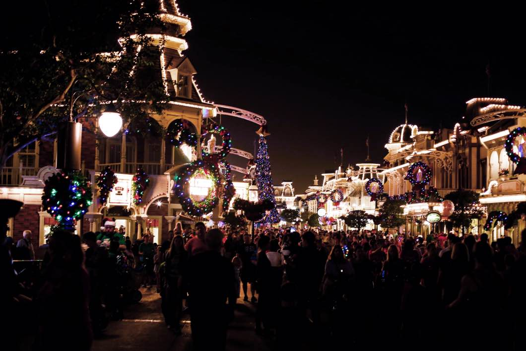 Mickey's Very Merry Christmas Main Street - Holiday Attractions in Orlando by Atlanta travel blogger Happily Hughes
