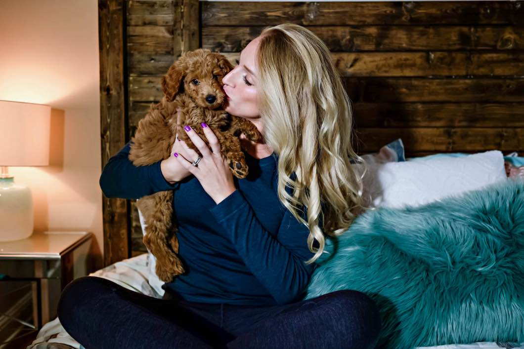 golden doodle snuggle fest - Best Warm Clothes For Cold Weather by Atlanta fashion blogger Happily Hughes