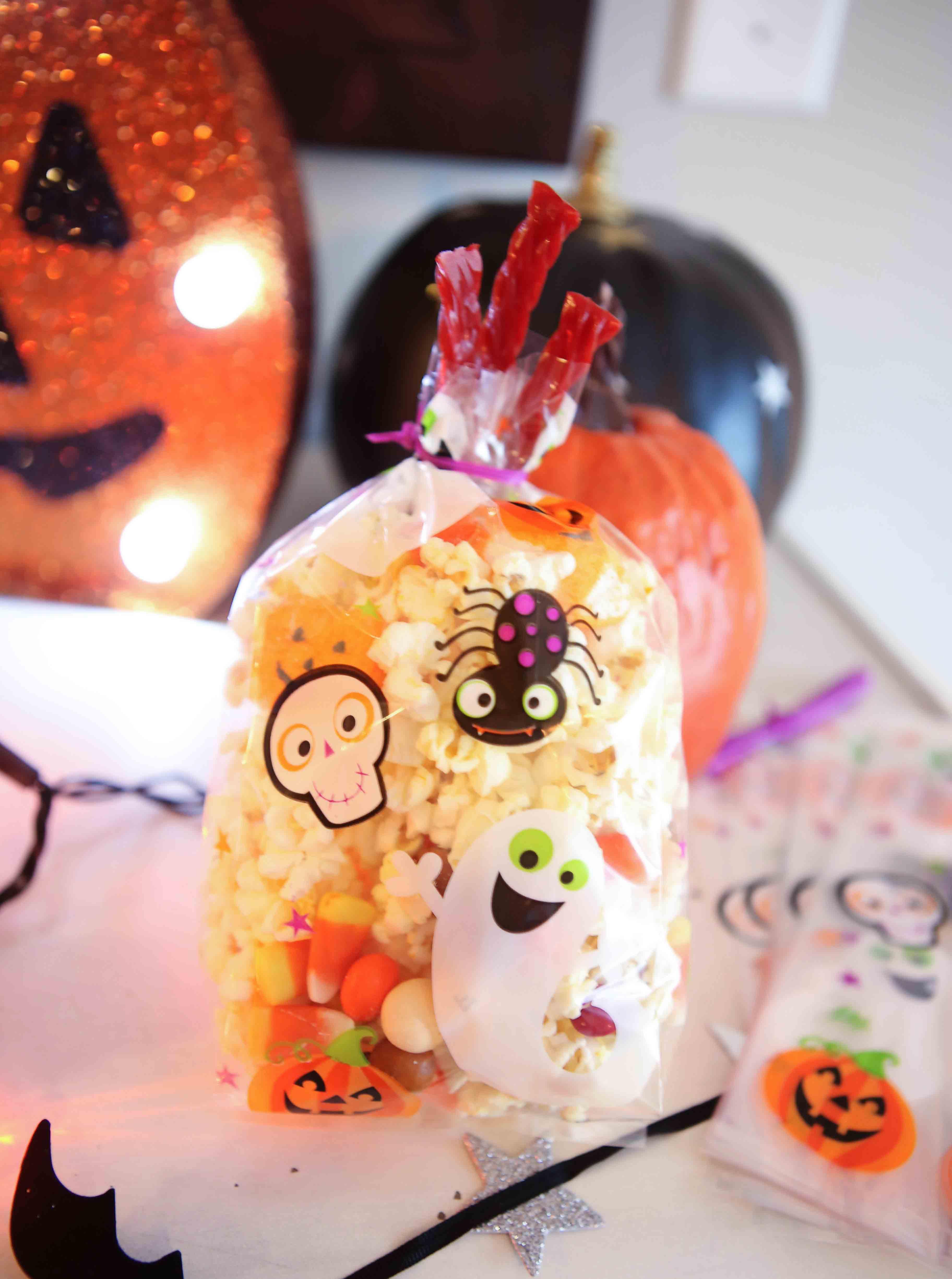 candy for popcorn bar - Halloween Popcorn Bar by Atlanta lifestyle blogger Happily Hughes